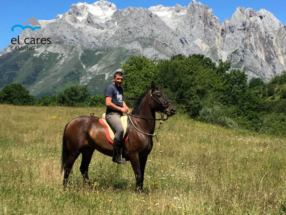 a-man-doing-horseback-riding-through-Picos-de-Europa